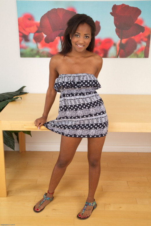 Ebony dime Ivy Sherwood bares her big tits as she undresses in courtyard  1516485