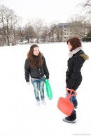 Two cute girls on a sled