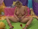 Busty Allysia playing with her pierced pussy