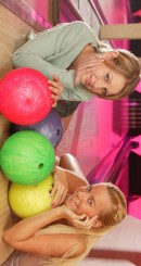 Rosie C & Esmeralda A - Young lesbians fuck each other in the bowling alley