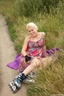 Roller skate girl Cathy pleases herself