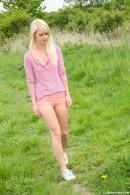 Sara gets naked outdoors