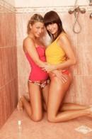 Rachel E & Christine D - Busty lesbian teens have fun in shower