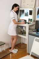 Kittina Ivory in Naughty Nurse Toying Herself At Work gallery from CLUBSEVENTEEN