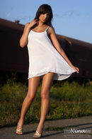 In White Silky Dress In Sunset