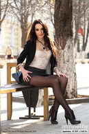 In Black Pantyhose Legplaying On The Street