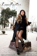 In Black Pantyhose And Boots