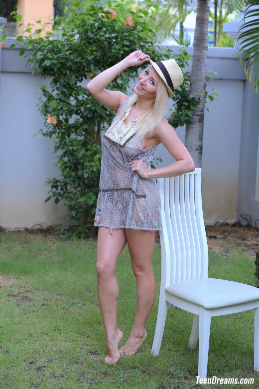 Isabella B In A Short Dress And Hat Getting Naked Under A Palmtree gallery from TEENDREAMS