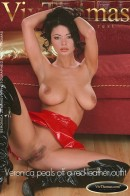 Veronica peals off a red leather outfit