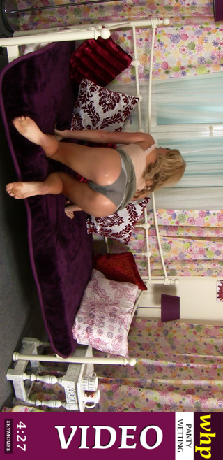 Natalia squats down to wet herself video from WETTINGHERPANTIES by Skymouse