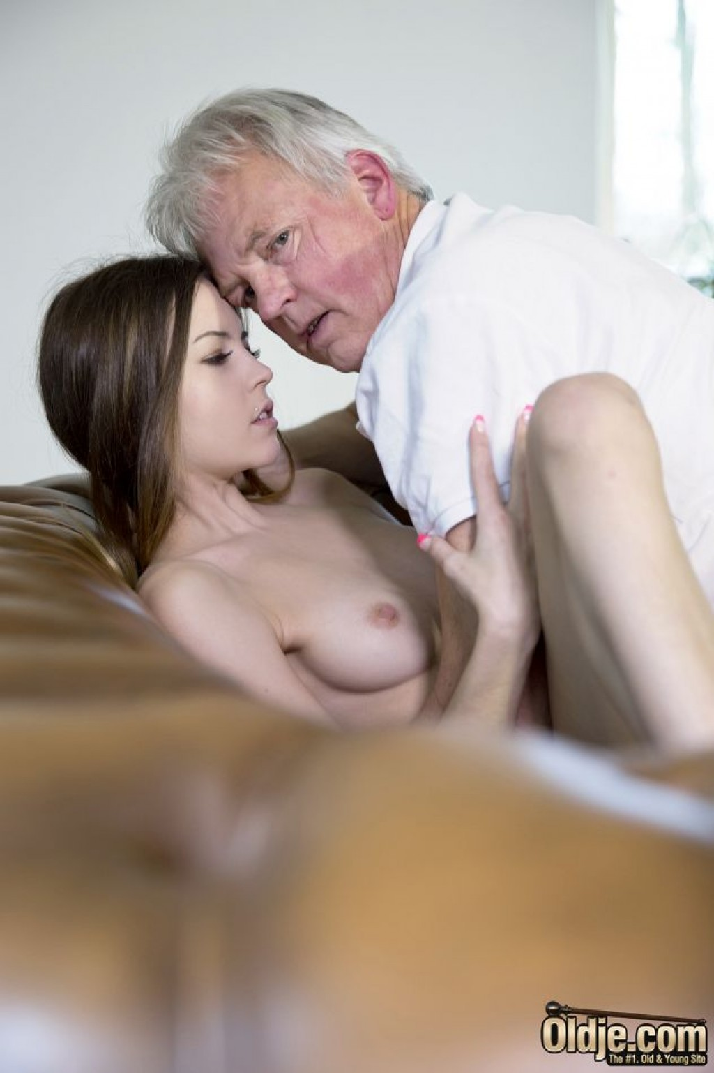 Young perfect girl with two old men