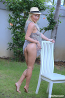 Isabella B In A Short Dress And Hat Getting Naked Under A Palmtree gallery from TEENDREAMS - #10